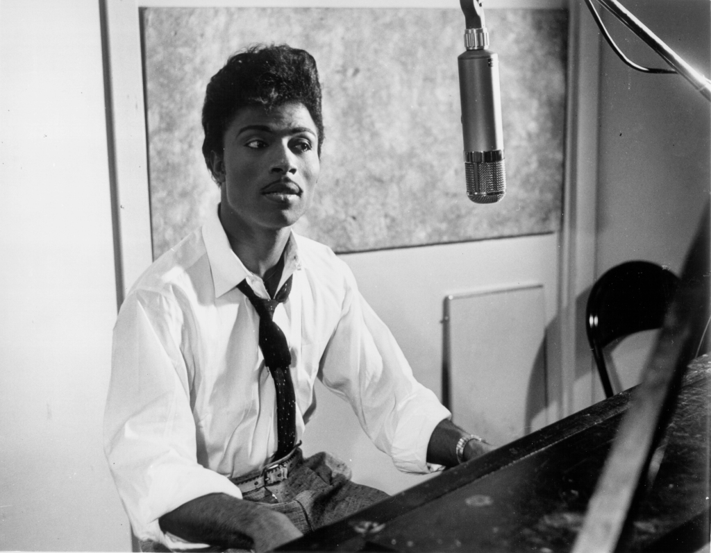 CIRCA 1959:  Musician Little Richard performs on the recording studio at a microphone and piano in circa 1959. (Photo by Michael Ochs Archives/Getty Images)